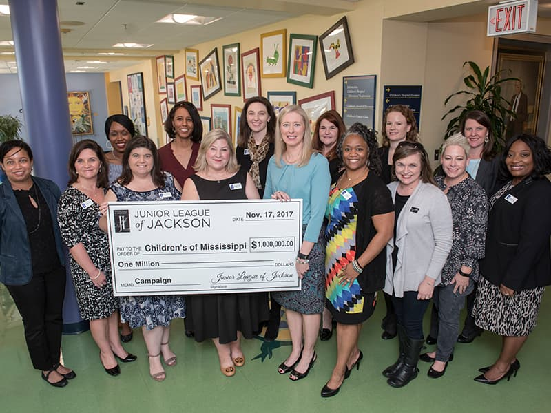 Junior League of Jackson members surround Noel in celebrating the organization's $1 million commitment to the Campaign for Children's of Mississippi.