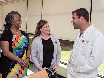 unior League of Jackson members, from left, Jia Scott and Lorraine Boykin talk with Dr. Brian Kogon, chief of pediatric cardiothoracic surgery.