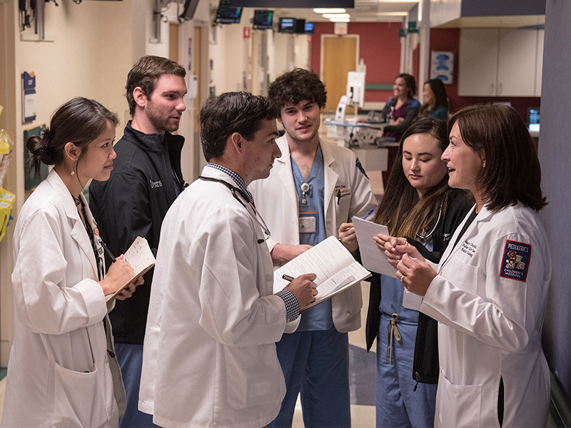 n her role as chair of the Department of Pediatrics, Taylor, right, also leads educational efforts. Here, she takes a group of medical learners, from left, Anne Folks, John Weldy, Griffin Metcalf, Stephen Stone and Bridgett Cheng on rounds at Batson Children's Hospital.