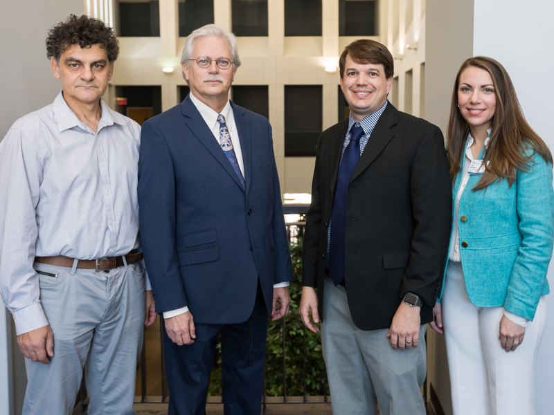 Patent recipient Dr. Drazen Raucher, left, and Dr. Lee Bidwel, second from right, with Summers and Musshafen.