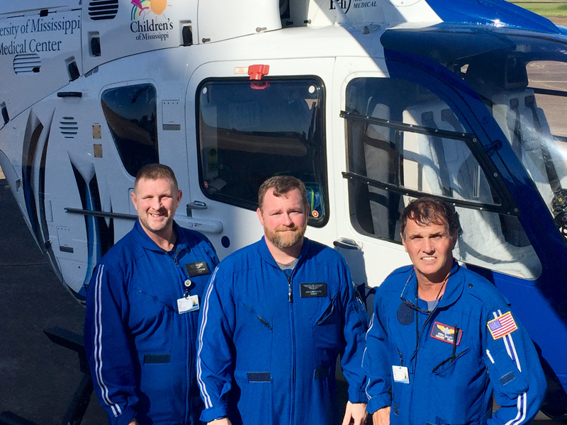 Staff members for AirCare 4 in Greenwood include, from left, registered nurse Kevin King, critical care paramedic Jack Hourguettes and pilot Keith Bailey.