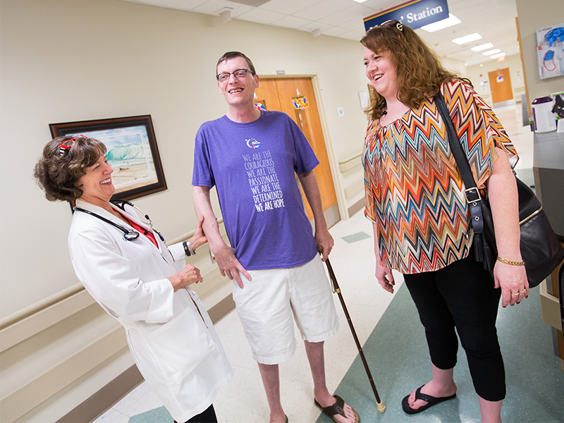 Dr. Carolyn Bigelow, left, greets Caleb and Melissa Rich during a follow-up visit for Caleb at the UMMC Bone Marrow Transplant Unit. Caleb had a stem cell transplant in 2013.