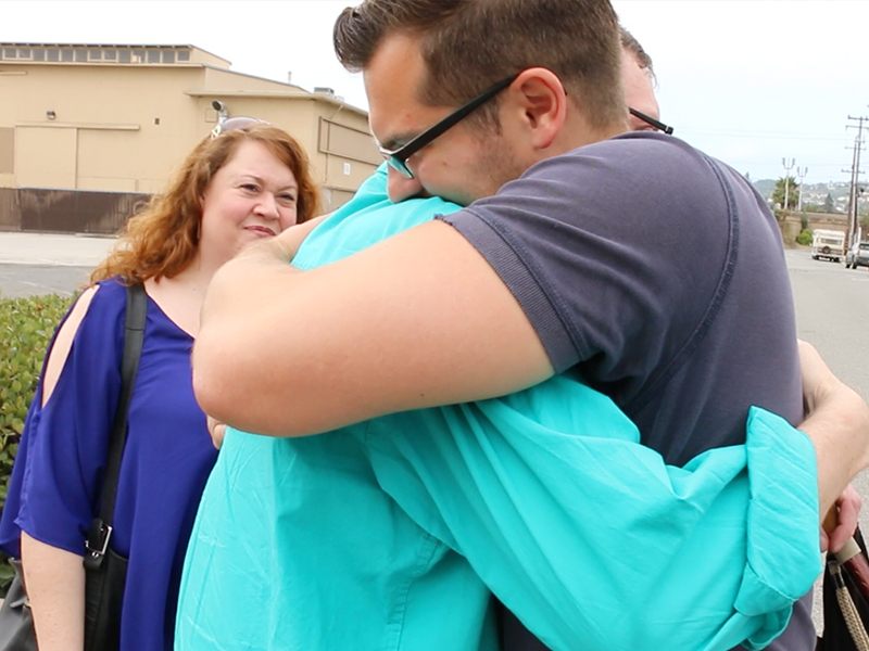 Caleb and Torrey hug after the after meeting for the first time. (Photo courtesy Alex Kimura.)