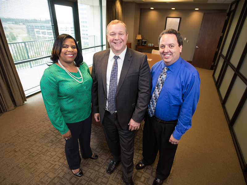 Leaders of the UMMC Center for Telehealth include, from left, clinical director Tearsanee Davis, executive director Michael Adcock and IT director Greg Hall.