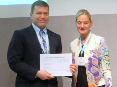 Pugh, left, accepts the award for Most Innovative Paper of 2016 from Planta Medica in Basel, Switzerland, on Monday, Sept. 4. Submitted photo