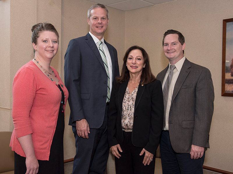 The CHDP team from UMMC includes, from left, clinical lead for developmental pediatrics Dr. Barbara Saunders, clinical lead for psychology Dr. David Elkin, principal investigator Dr. Susan Buttross and Dr. Dustin Sarver, UMMC director of workforce training. Dr. Robert Annett, CHDP research director, is not pictured.