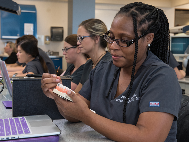 First-year dental student Jaleesa Dandridge capitalizes on some of the knowledge she gained during the Pre-Matriculation Summer Educational Enrichment Program, administered by the Office of Health Careers Opportunity for entering dental and medical students.