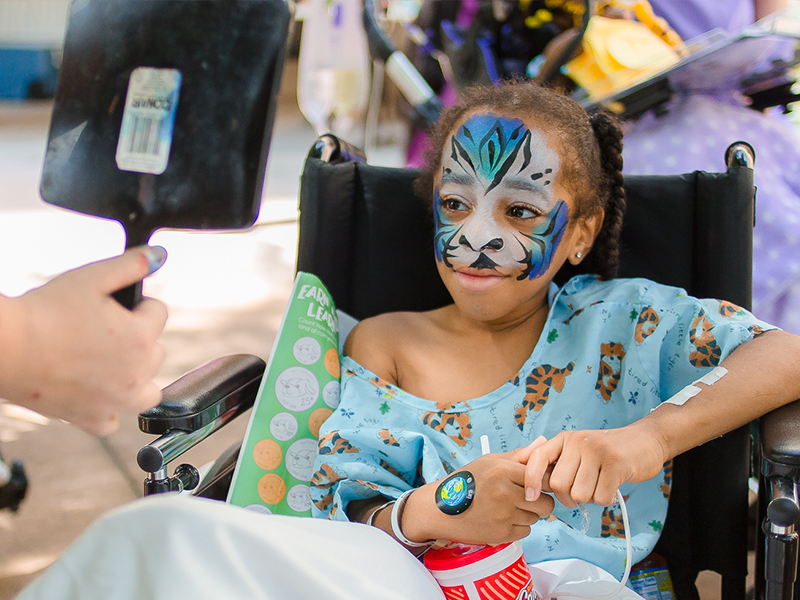 Batson Children's Hospital patient La'Quan Bradley of Natchez smiles at his tiger-painted reflection.