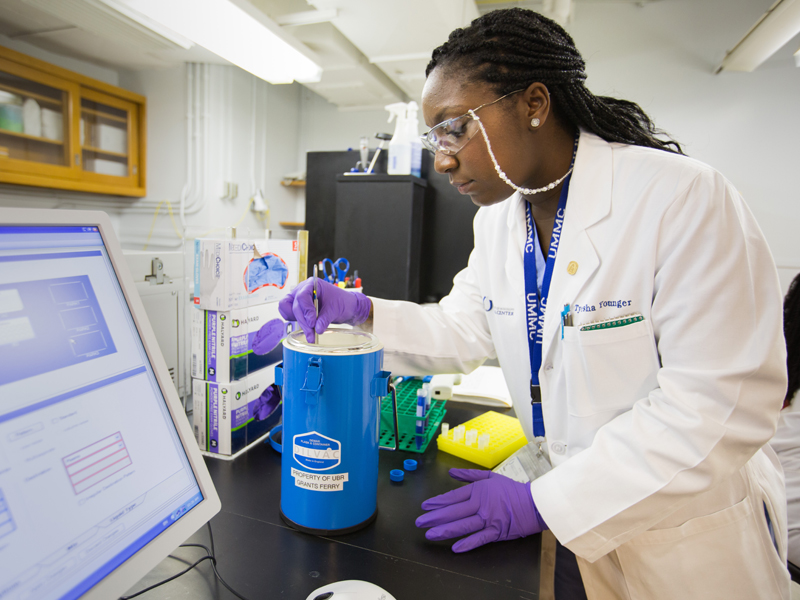 Tyesha Younger, a biorepository specialist, checks super-chilled samples in UMMC's biobank. UMMC was selected as an enrollment site for All of Us, an NIH-sponsored study that will collect health data and specimens from one million Americans.