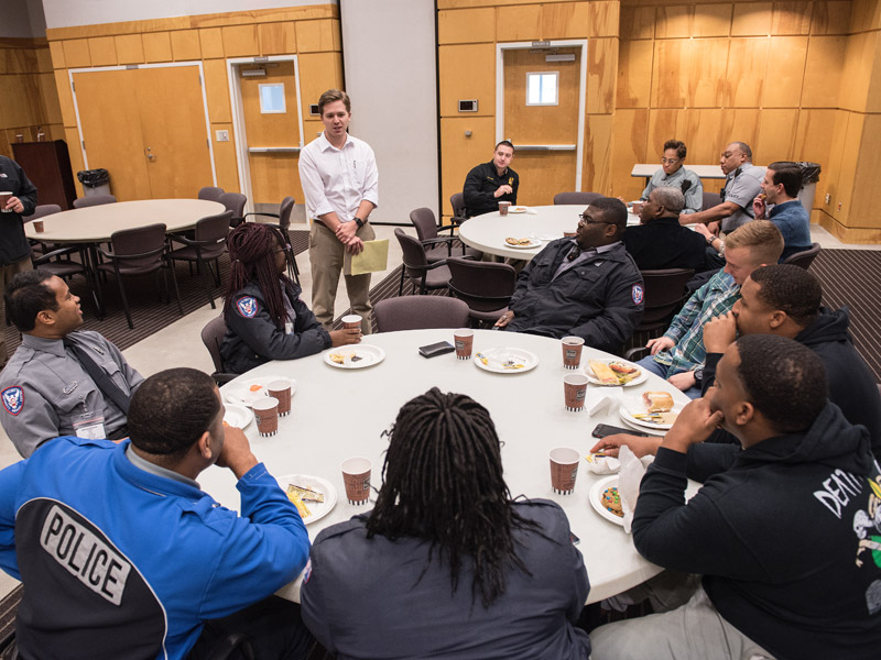 Associated Student Body President Will Thomas, center, welcomes campus police officers and staff to an appreciation luncheon sponsored Tuesday by the ASB.