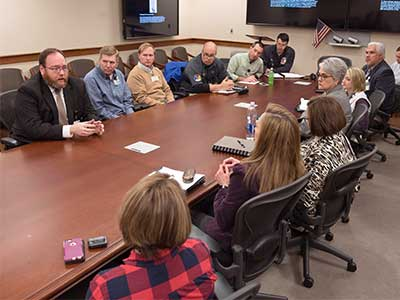 Chief Administrative Officer Jonathan Wilson (top left) briefs an administrative team Friday about relocating the Medical Center's clinical operations at the Jackson Medical Mall.