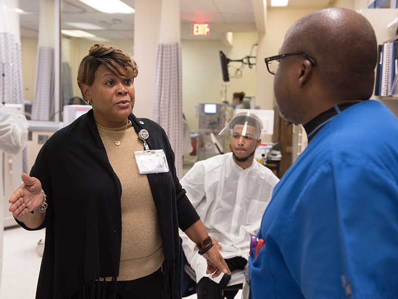Alice Luckett, UMMC clinical director of dialysis, discusses where to locate an influx of patients with Jessie Austin, a dialysis biomedical engineering technician.