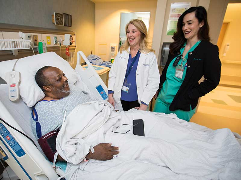 Seawright, center, and registered nurse Engaray Porter visit with transplant patient Johnny Coleman of Mobile, Ala.
