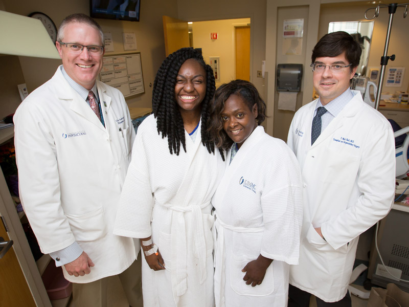 On April 3, Bettina Dixon, left center, and Roda Barnes, right center, shared the organ in a very rare split-liver surgery performed by Dr. Christopher Anderson and Dr. Mark Earl.