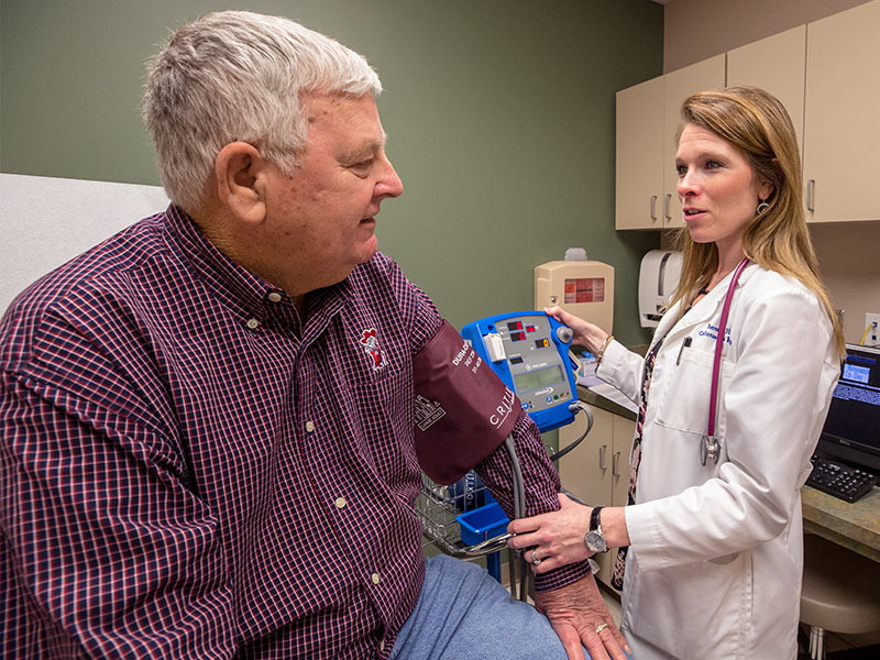 Theresa Hutson, clinical research coordinator, takes a blood pressure measurement for Billy Pittman of Florence. Pittman visited the clinics to learn about a heart failure study, one of many ways UMMC is researching cardiovascular disease.