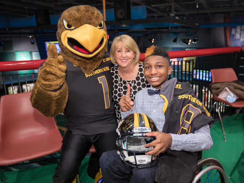 University of Southern Mississippi mascot Seymour and Mississippi First Lady Deborah Bryant congratulate the state's 2018 Children's Miracle Network Hospitals Champion KJ Fields at a Wednesday announcement at the Mississippi Sports Hall of Fame.