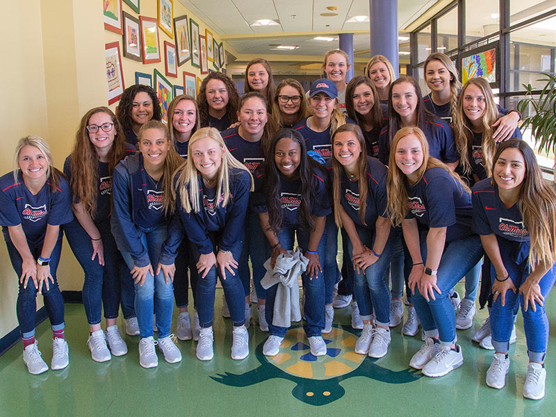 Ole Miss softball players paid a visit to Batson Children's Hospital Tuesday on their way to a game against Southeast Louisiana State in Hammond, Louisiana.