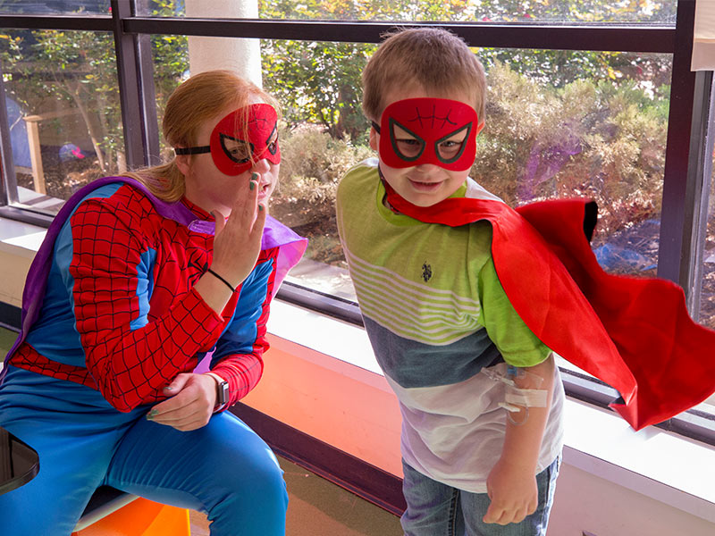 Spider-Man has a couple of helpers: Ole Miss softball player Izzy Werdann and Batson Children's Hospital patient Jase Thorpe of Brookhaven.