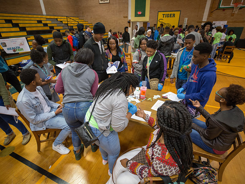 Glucose testing was offered by Jim Hill High Health Academy students to their classmates during a wellness fair.