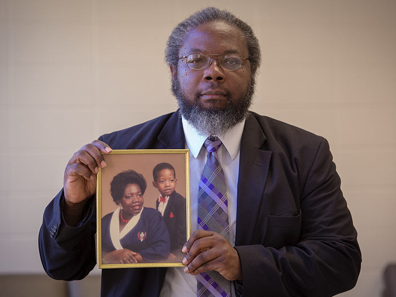 Dr. Stanley Smith holds a photo of his sister, Dorothy Ann Johnson, and her son, Shannon, close to his heart.