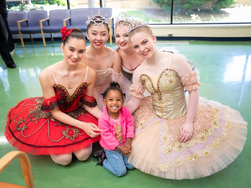 isiting Batson Children's Hospital, Taylor Carr of McComb smiles with Mississippi Metropolitan Ballet dancers, from left, Mattie Grace Morris of Brandon, Abigail McCaughan of Ridgeland, Josie Nasekos of Clinton and Taylor Binkley of Brandon.