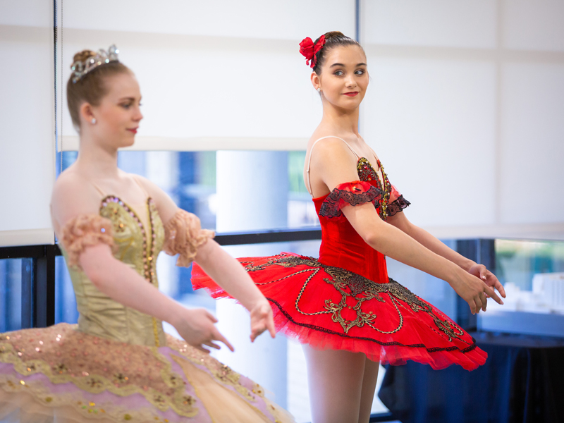 From left, Mississippi Metropolitan Ballet dancers Taylor Binkley and Mattie Grace Morris demonstrate the second position in a ballet learning lab.