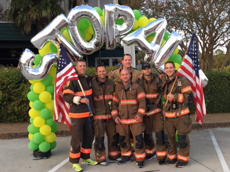 Members of the Reservoir Fire Department, including Quinton Robertson in back center, at the 2017 Brawn and Bubbles 5K.