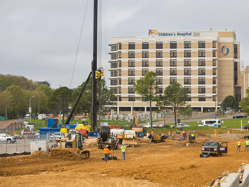 Construction of the new Children's tower is underway beginning with a new access road from East University Drive.