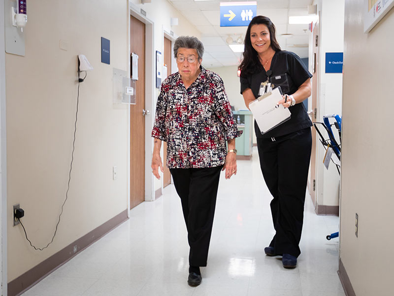 Peggy Dudley performs a walking test for Kristy Womack, structural heart coordinator in the Adult Heart Valve Program.