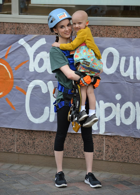 "Natalie Joiner, one of the ""Edgers"" rappelling at Over The Edge, holds her inspiration, Batson Children's Hospital patient Iva Beth Lindsey."