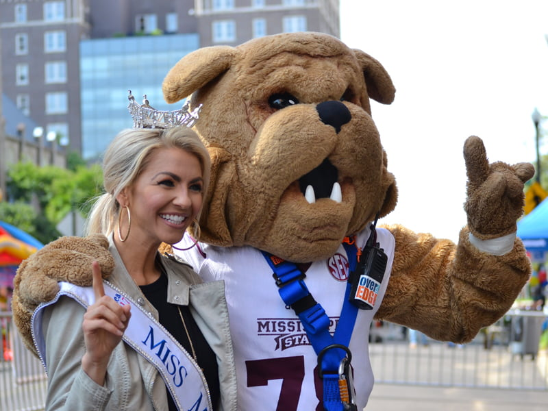 Miss Mississippi Anne Elizabeth Buys smiles with Mississippi State University mascot Bully. who was among those rappelling in Over The Edge for Friends of Children's Hospital.