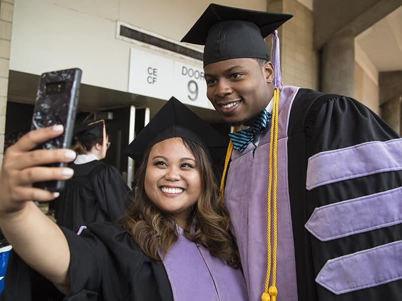 School of Dentistry graduates Maureen Malingkas, left, and Jiman Nelson take a celebratory selfie.