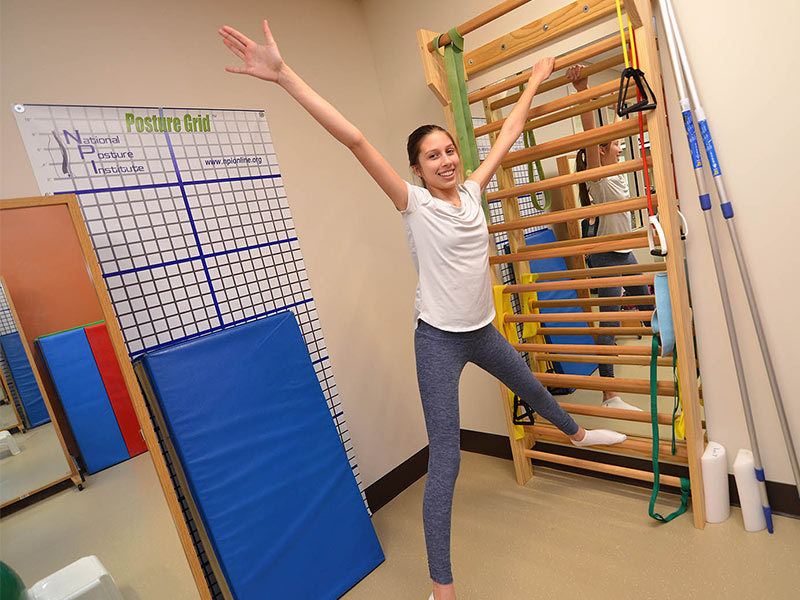 Deanna Wilbourn of Madison performs an advanced exercise known as the St. Andrew's Cross as part of her Schroth Therapy regimen at Methodist Outpatient Therapy in Ridgeland.