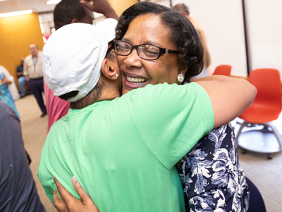 Triplett received many hugs during her retirement reception. She has made many friends in the past 44 years.