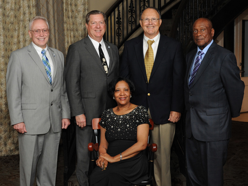 Triplett was elected as the 2015 Friend of the School of Dentistry. Behind her are four of the deans she served, from the left, Dr. Gary Reeves, Dr. James Hupp, Dr. Butch Gilbert and Dr. Willie Hill.
