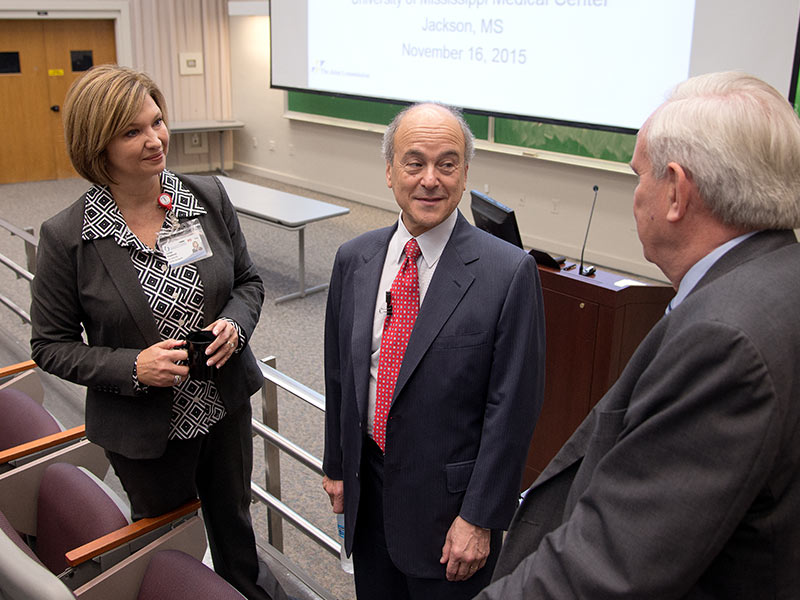 Visiting with Chassin during his 2015 visit to UMMC were Dr. Michael Henderson, UMMC chief medical officer, right, and Dr. LouAnn Woodward, vice chancellor for health affairs and dean of the School of Medicine.