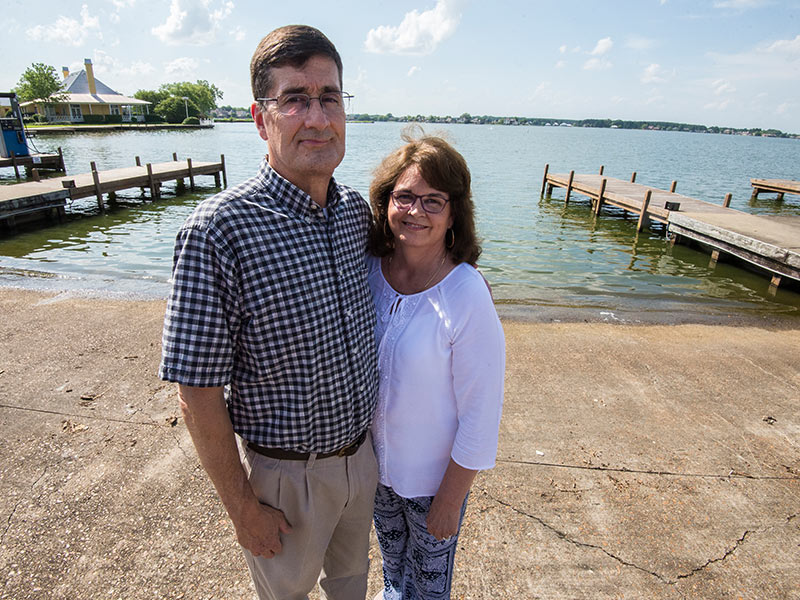 Madison residents Dan and Ann Smith stand at the dock on Lake Caroline where Dan in April 2017 suffered catastrophic injuries in a boating accident.
