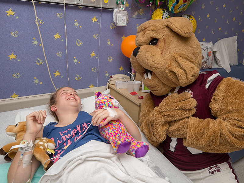 Mississippi State coach, players cheer on Batson patients