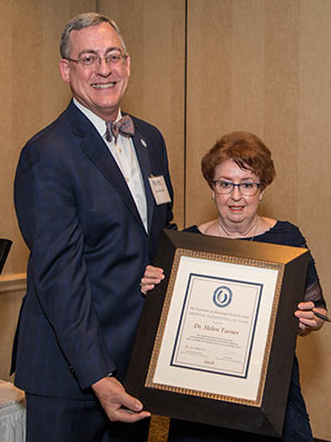 Dr. Helen Turner, right, associate vice chancellor emeritus, is one of five Hall of Fame inductees who were presented with framed certificates by Dr. Tim Folse, outgoing Medical alumni Chapter president.
