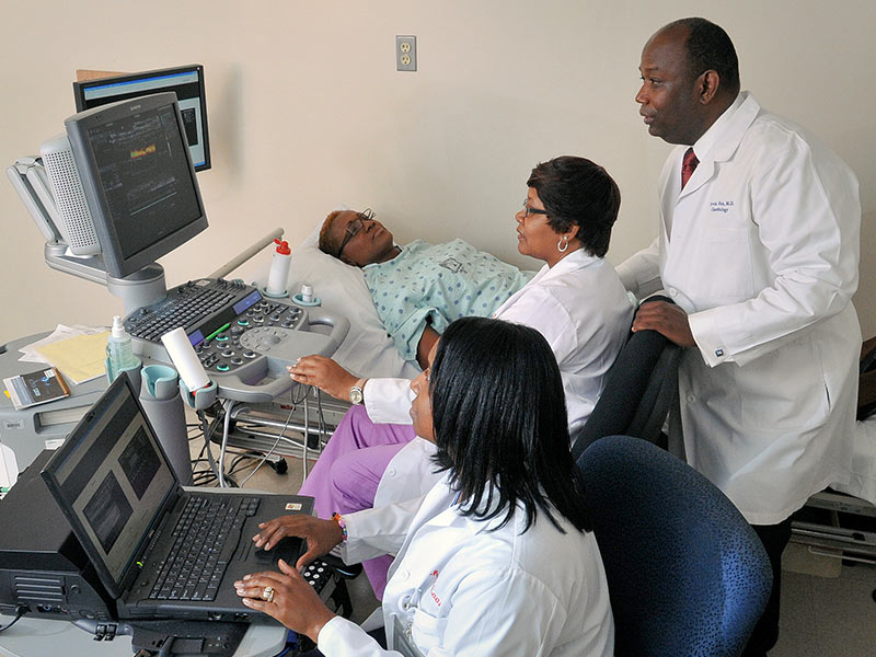 The Jackson Heart Study has been renewed. Since 1998, the NIH-funded project has enabled researchers at UMMC, Jackson State University and Tougaloo College to study cardiovascular health and disease in African-Americans. The study includes physical exams, like the one shown here from 2012 where Dr. Ervin Fox, professor of medicine, monitors as Shari Cook, foreground, and Audrey Samuels, center, take readings from a participant.