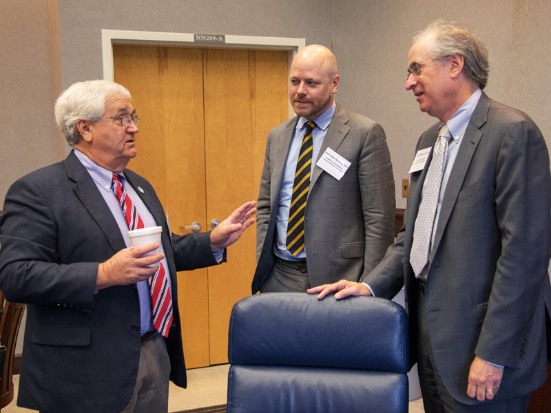 Dr. John Mitchell, left, chats with Paul Johnson, ACGME executive director and Institutional Review Committee member; and Dr. Kevin Weiss, ACGME senior vice president, in Institutional Accreditation.