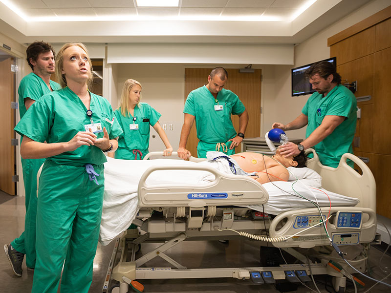 During one of several simulated emergency cases, Dr. Erin Walker, foreground, leads a team of her fellow Emergency Medicine residents:  from left, Dr. Macon Morris,  Dr. Paige Bell, Dr. Joshua Rouhan and Dr. Harold Gage.