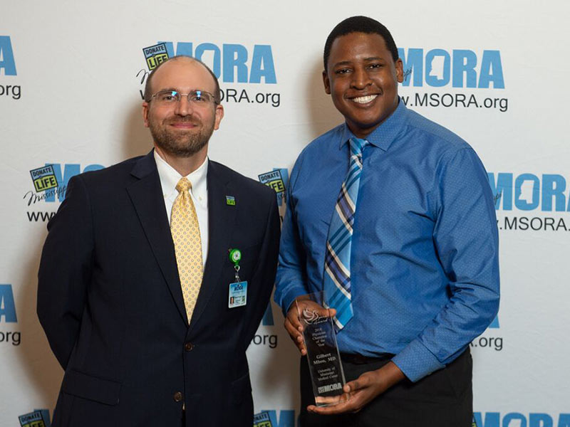 Dr. Gilbert Mbeo, right, assistant professor of neurology, is MORA's Physician Champion of the Year. He's pictured with Russell Touchet, MORA chief business officer.