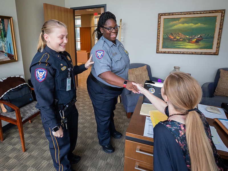 Lt. Toni Sumrall, left, of UMMC Campus Police, introduces Davenia Bass, a new security officer, to Stephanie Lucas, director of research operations for the Department of Physiology and Biophysics.