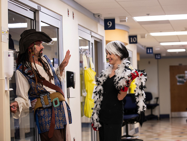 Chief of pediatric critical care Dr. Jarrod Knudson, dressed as Capt. Jack Sparrow, consults with Cruella De Vil, aka PICU nurse manager Shelly Ivers Craft.