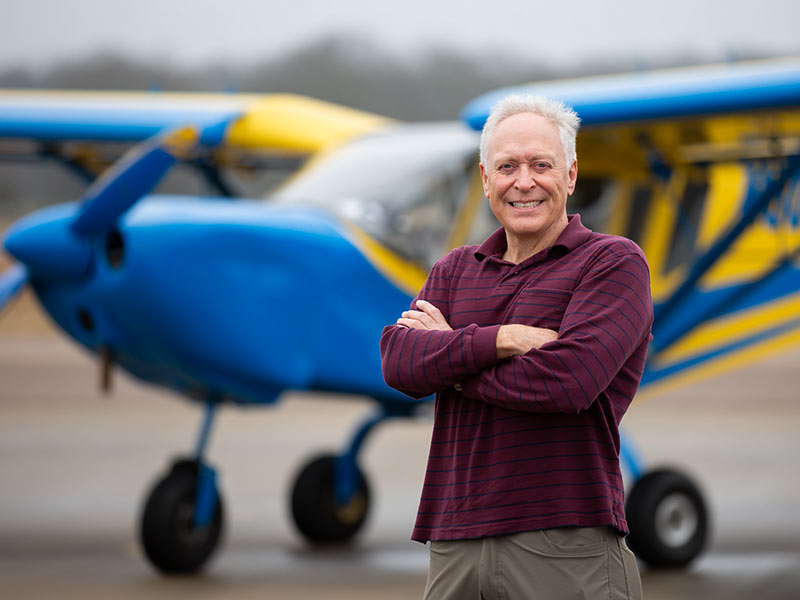 fac48b3ef Dr. Gary Reeves stands in front of the Zenair 801 that took him about 10