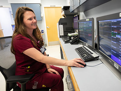 Jennifer Brooks, UMMC Grenada nurse, uses a new telemetry system on a hospital floor.