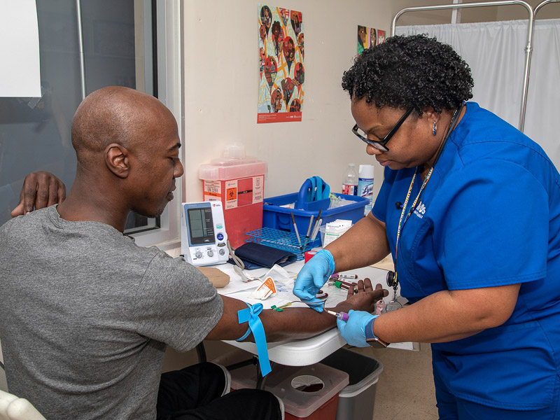 Sharron Vaughn. UMMC biobank recruiter, draws blood from Travis Key of Jackson for the All of Us research study.