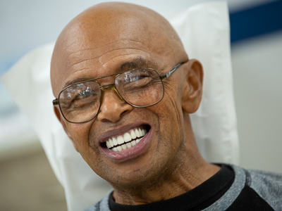 Smiling patient after he has received new dentures.