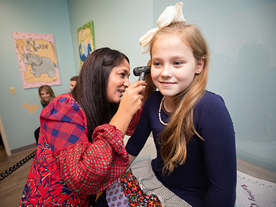 Sethi with young patient, Lilly Hart, 9, who's getting her ears checked